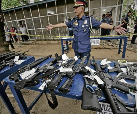 "ABRA GUNS Chief Supt. Benjamin Magalong, Cordillera police director, displays the weapons surrendered by politicians in Abra, one of the ""areas of concern"" declared by the Commission on Elections for their history of election violence. The guns will be muzzled and kept at Camp Juan Villamor in the provincial capital of Bangued as the Comelec imposes a gun ban during the midterm elections. RICHARD BALONGLONG/INQUIRER NORTHERN LUZON"