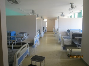 Adult ward with a couple of already setup beds