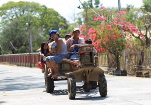 Using farm equipment for transportation. Photo by Rem Zamora