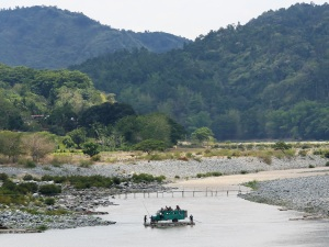 A local ferry transports a jeepney across the Abra River. (photo by Healing Earth)