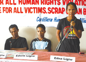 In Photo: Edna Ligiw (right), with her brothers Edwin (center) and Jessie, talks to the media in the office of the Cordillera Human Rights Alliance in Baguio City, recounting the horrific death of their father and two brothers reportedly at the hands of the 41st IB of the Armed Forces of the Philippines. (Larry Fabian)