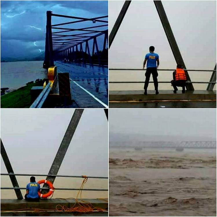 The wrath of Typhoon Ineng plowing into the Province of Abra causing swelling of the mighty Abra River. Police and Rescue officers (we salute you sir) keenly inspecting the onslaught along the Calaba Bridge ready to help if needed. These photos were sent to us without giving us the source. Please do let us know if these are your photos and will credit you for them.